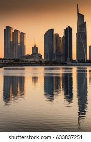 Dusk silhouettes of Jumeirah lakes towers reflected in water, Dubai, United Arab Emirates