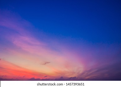 Dusk Sky in the Evening,Amazing Dramatic and Wonderful Cloud on Twilight,Majestic Dark Blue Sky Nature Background,Colorful Cloud on Sunset,Idyllic Dusk peaceful sunlight on nightfall.