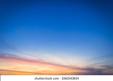 Dusk sky on twilight in the evening,majestic sunset with dramatic sunlight on dark blue sky on summer season,idyllic peaceful nature background.
