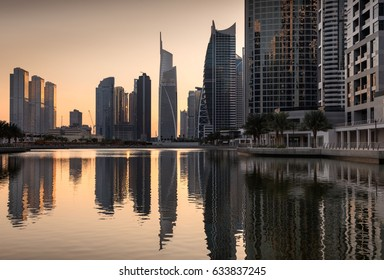 Dusk skyline of Jumeirah lakes towers with clear reflections, Dubai, United Arab Emirates