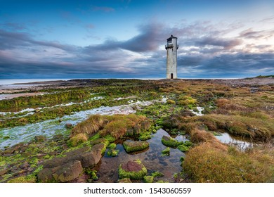 Dusk at Southerness lighthouse on the Galloway coastline in Scotland