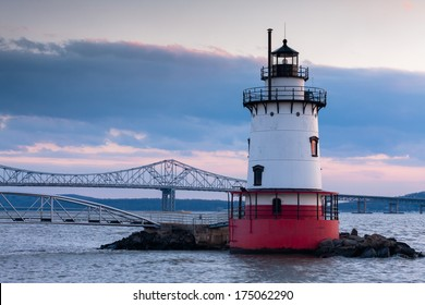 Dusk view of Tarrytown lighthouse with Tappan Zee bridge on the background