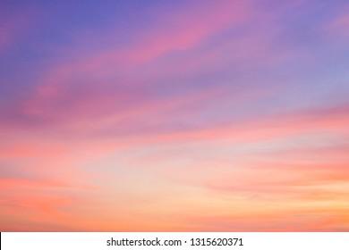 Dusk,Evening sky with colorful sunlight,Beautiful sunset cloud on twilight,majestic peaceful nature background,pink and orange,purple sunlight on cloud fluffy summer season sky.