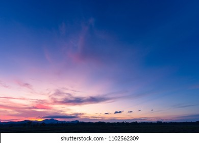 Dusk,Evening Sky,Amazing Colorful sky and Dramatic Sunset,Majestic Sunlight Cloud fluffy,Idyllic Nature Peaceful Background,Beauty Dark Blue,Purple Nightfall over Silhouette mountain on twilight sky
