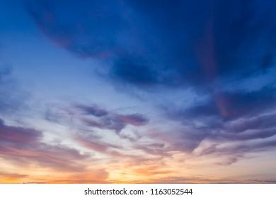 Dusk,Sky in the Evening,Dramatic and Wonderful fluffy Cloud on Twilight,Majestic Dark Blue Sky Nature Background,Colorful Cloud on Sunset sky,idyllic peaceful sunlight.