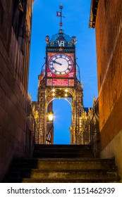 A dusk-time view of the Eastgate Clock viewed from the city walls in the historic city of Chester in Cheshire, UK.