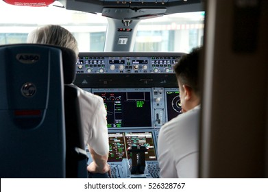 DUSSELDORF - 22nd JULY 2016: Singapore Airlines Airbus A350-900 cockpit with pilots preperaing the inaugural flight to Singapore.