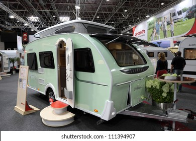 789e4692ff DUSSELDORF - AUGUST 27  Dethleffs Tourist mobile home with elevating roof  at the Caravan Salon