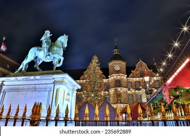 Dusseldorf Christmas Market and historic city hall. Dusseldorf's Christmas Market turns the city into a winter's fairy tale with seasonally decorated huts and magic atmosphere.