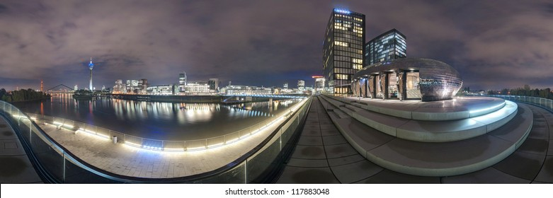 Dusseldorf at dusk. 360 degree panoramic composition.