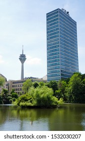 DUSSELDORF, GERMANY. 31st May 2019. A view of the tower block housing the government offices of Ministry of Economy, with the Rhine Tower in the background and the lake of the Spee'scher Graben.