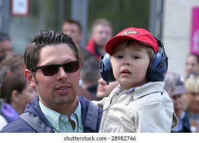 DUSSELDORF, GERMANY - APRIL 19: An unidentified father and his little son watch the presentation of the DTM 2009 right next to the track April 19, 2009 in Dusseldorf, Germany.
