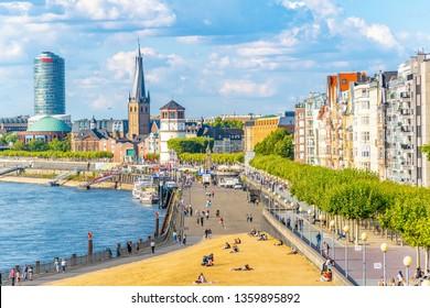 DUSSELDORF, GERMANY, AUGUST 10, 2018: Riverside of Rhein in Dusseldorf with Saint Lambertus church, Germany