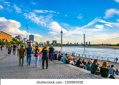 DUSSELDORF, GERMANY, AUGUST 10, 2018: People are enjoying a summer day on riverside promenade in Dusseldorf, Germany