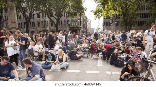 Dusseldorf, Germany - August 13, 2016: Pokemon Go. A crowd of Pokemon Go players converged on a bridge across the Koeningsalle, a major road in Dusseldorf, blocking all traffic.