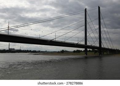 DUSSELDORF, GERMANY - AUGUST 6, 2012: Bridge over the Rhine River in Dusseldorf, North Rhine-Westphalia, Germany.