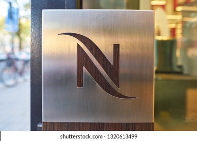DUSSELDORF, GERMANY - CIRCA SEPTEMBER, 2018: close up shot of Nespresso sign at a Nespresso store in Dusseldorf. Nespresso machines brew espresso and coffee from coffee capsules, or pods.