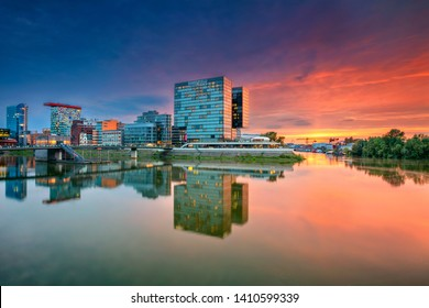 Dusseldorf, Germany. Cityscape image of Düsseldorf, Germany with the Media Harbour and reflection of the city in the Rhine river, during beautiful sunset.