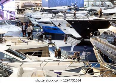 DUSSELDORF, GERMANY - JAN 21, 2019: Visitors viewing the various luxury yachts showcased during the BOOT Dusseldorf International Boat Show 2019.