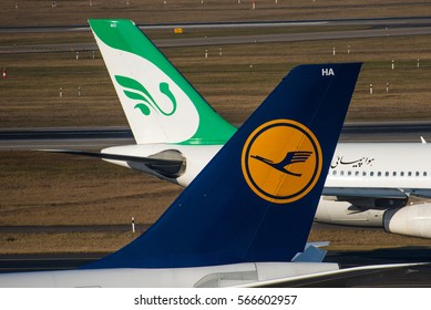 DUSSELDORF / GERMANY - JANUARY 2017 Aircraft tails of a Lufthansa A340-600 (D-AIHA) and a Mahan Airlines A340-300 (EP-MMD)
