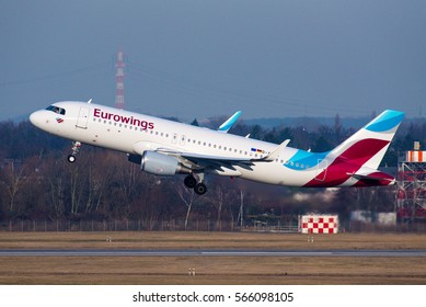 DUSSELDORF / GERMANY - JANUARY 2017 Eurowings Airbus A320-214(WL), D-AEWS. cn 7439 banking left after becoming airborne to counteract the strong crosswind.