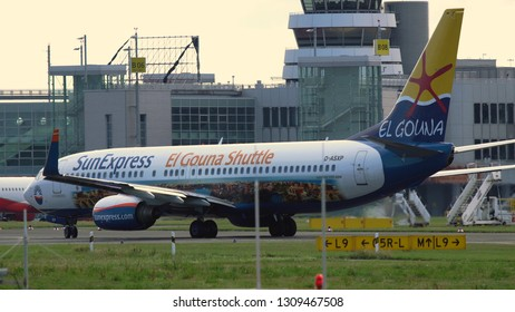 DUSSELDORF, GERMANY - JULY 21, 2017: Rear view of Boeing 737-8HX of SunExpress (El Gouna Shuttle Livery) in Dusseldorf airport