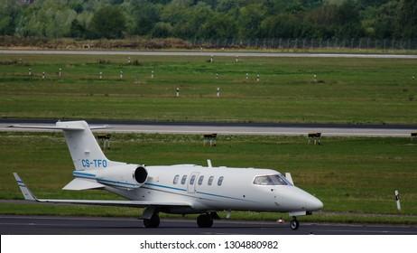 DUSSELDORF, GERMANY - JULY 23, 2017: Side view of Learjet 40 CS-TFO of OMNI Aviation before takeoff