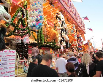 DUSSELDORF, GERMANY - JULY 24: Visitors at Lottery Stall at Kirmes on July 24, 2010 in Dusseldorf, Germany. Kirmes is the biggest summer fair on the north Rhein in Germany.
