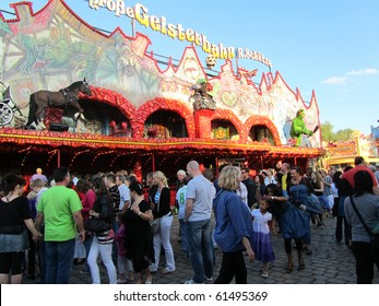 DUSSELDORF, GERMANY - JULY 24: Visitors at Ghost Train Ride at Kirmes on July 24, 2010 in Dusseldorf, Germany. Kirmes is the biggest summer fair on the north Rhein in Germany.