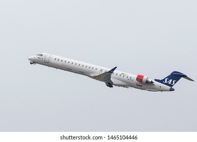 Dusseldorf, Germany - July 28, 2019. An SAS Bombardier CRJ-900 (EI-FPF) takes off from Dusseldorf Airport.