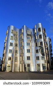DUSSELDORF, GERMANY - JULY 29, 2012: Modern distorted office building by architect Frank O. Gehry with silver facade in Dusseldorf Media Harbor (Medienhafen) district on July 29, 2012 in Dusseldorf.