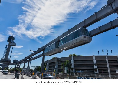 Dusseldorf, Germany - July 3, 2018: Public transportation system Sky-Train hanging from elevated guideway beam on columns in Dusseldorf, Germany. The SkyTrain, takes passengers to the airport terminal