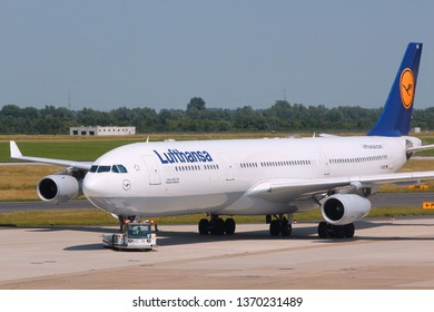 DUSSELDORF, GERMANY - JULY 8, 2013: Lufthansa Airbus A340 at Dusseldorf Airport, Germany. Lufthansa Group carried over 103 million passengers in 2012.