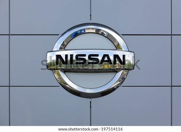 Dusseldorf, Germany - June 12, 2011: Nissan logo at the wall of car dealer's building. Nissan Motor Company Ltd is a multinational car manufacturer headquartered in Yokohama, Japan.