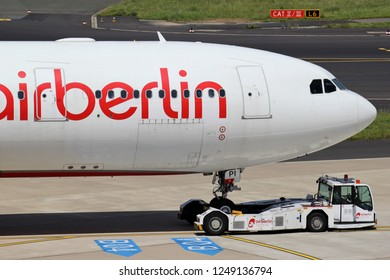 DUSSELDORF, GERMANY - JUNE 7, 2014: Air Berlin Airbus A330-200 with registration D-ALPI being towed at Dusseldorf Airport. Air Berlin filed for insolvency on 15 August 2017.