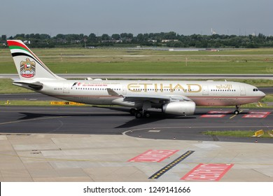 DUSSELDORF, GERMANY - JUNE 7, 2014: Etihad Airways Airbus A330-200 with registration A6-EYR on taxiway of Dusseldorf Airport.