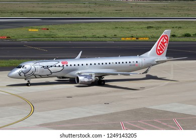 DUSSELDORF, GERMANY - JUNE 7, 2014: Austrian Niki Embraer ERJ-190 with registration OE-IHD on taxiway of Dusseldorf Airport.