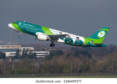 """DUSSELDORF / GERMANY - MARCH 2019 Aer Lingus Airbus A320-214, EI-DEO, cn 2486, climbing away on its way to Dublin. Wearing """"Green Spirit cs"""" promoting the Irish Rugy Team."""