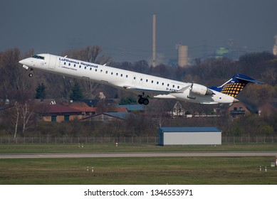 DUSSELDORF / GERMANY - MARCH 2019 Lufthansa Regional (Lufthansa CityLine) Bombardier CRJ-900LR (CL-600-2D24), D-ACNW, cn 15269 climbing into a blue spring sky over DUS.