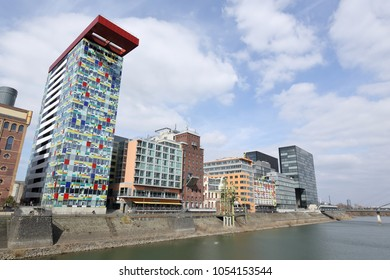 DUSSELDORF, GERMANY - MARCH 24, 2018: Old warehouses and modern office buildings in trendy Media Harbour district on March 24, 2018 in Dusseldorf.