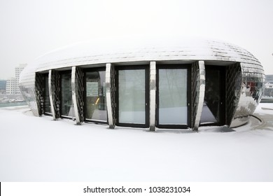 DUSSELDORF, GERMANY - March 3, 2018: Winter view of futuristic building with silver tiled facade  in the Media Harbour (Medienhafen) district on March 3, 2018 in Dusseldorf.