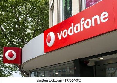 Dusseldorf, Germany - May 14, 2011: Sign at Vodafone store. Vodafone Group plc is the world's largest global telecommunications company measured by revenue and is headquartered in London, UK.
