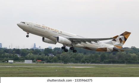 DUSSELDORF, GERMANY - MAY 26, 2019: Etihad Airways Airbus A330-243 (CN 729) takes off from Dusseldorf Airport.