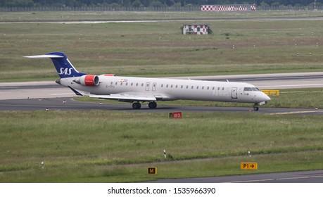 DUSSELDORF, GERMANY - MAY 26, 2019: SAS Canadair Regional Jet CRJ-900LR (CN 15426) taxi in Dusseldorf Airport.