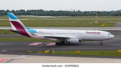 DUSSELDORF, GERMANY - MAY 26, 2019: Eurowings Airbus A330-203 (CN 612) taxi in Dusseldorf Airport.