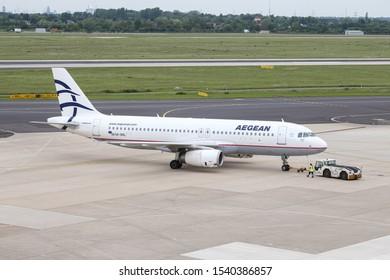 DUSSELDORF, GERMANY - MAY 26, 2019: Aegean Airlines Airbus A320-232 (CN 3423) push back in Dusseldorf Airport.