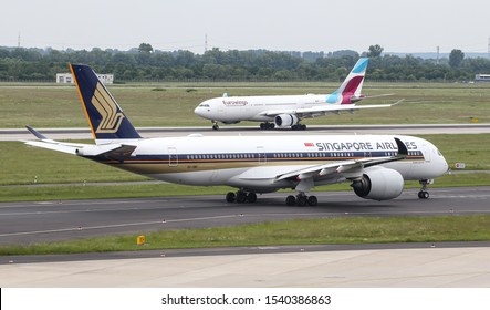 DUSSELDORF, GERMANY - MAY 26, 2019: Singapore Airlines Airbus A350-941 (CN 62) taxi in Dusseldorf Airport.
