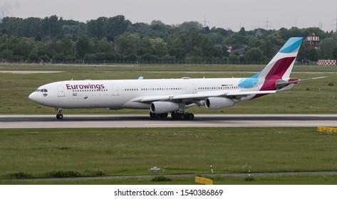 DUSSELDORF, GERMANY - MAY 26, 2019: Eurowings Airbus A340-313X (CN 335) taxi in Dusseldorf Airport.