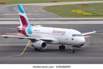 DUSSELDORF, GERMANY - MAY 26, 2019: Eurowings Airbus A319-132 (CN 5941) taxi in Dusseldorf Airport.