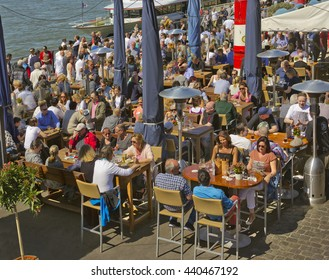DUSSELDORF, GERMANY - MAY 5, 2016: Restaurant filled with people on Rhine promenade